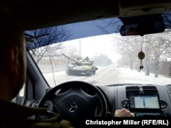A Ukrainian tank rumbles through the outskirts of Avdiyivka en route to a battlefield position.