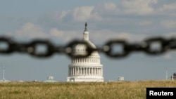 U.S. -- The Capitol is photographed through a chain fence in Washington September 30, 2013