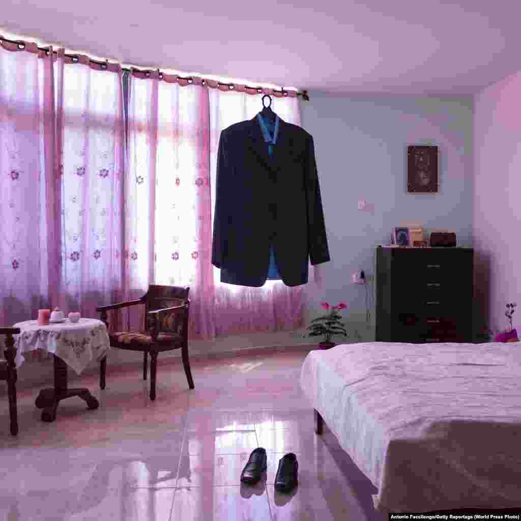 Part of a series titled Habibi. Nael al-Barghouthi's suit remains hanging in his bedroom in Kobar, near Ramallah, Palestinian Territories, on August 17, 2015. Al-Barghouthi's wife, Iman Nafi, keeps all her husband's clothes and belongings in place. Al-Barghouthi was arrested in 1978 after an anti-Israel commando operation. He was released in 2011, married Iman Nafi, but re-arrested in 2014 and sentenced to life imprisonment. He has spent more than 40 years in prison, the longest-serving Palestinian inmate in Israeli jails. World Press Photo Story of the Year: Winner - Antonio Faccilongo, Getty Reportage