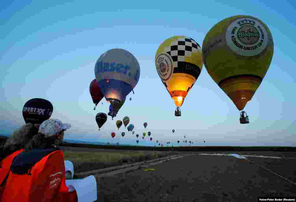 Judges watch competitors approaching a target during the FAI World Hot Air Balloon Championship near Gross-Siegharts, Austria,  on August 20. (Reuters/Heinz-Peter Bader)