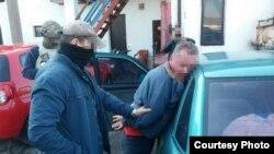 """Фотография задержания """"агента"""" ГРУ России, опубликованная на сайте СБУ"""
