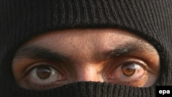 The face of a masked Basij member during a paramilitary forces parade (file photo)