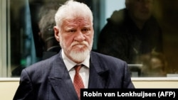 Slobodan Praljak at the court in the Hague shortly before the verdict was announced yesterday.