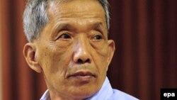 "Kaing Guek Eav, alias ""Duch,"" in the Phnom Penh courtroom for his initial verdict in July 2010"