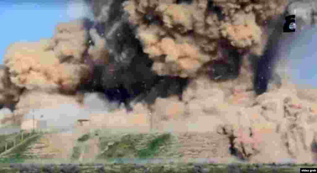 A screen grab of an explosion, identified as taking place in Nimrud