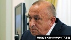 Олександр Соловйов слухає Володимира Путіна (за кадром) під час зустрічі з ним у серпні 2014 року