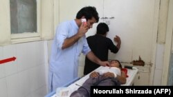 A wounded Afghan boy receives treatment at a hospital following the attack in Jalalabad on September 11.
