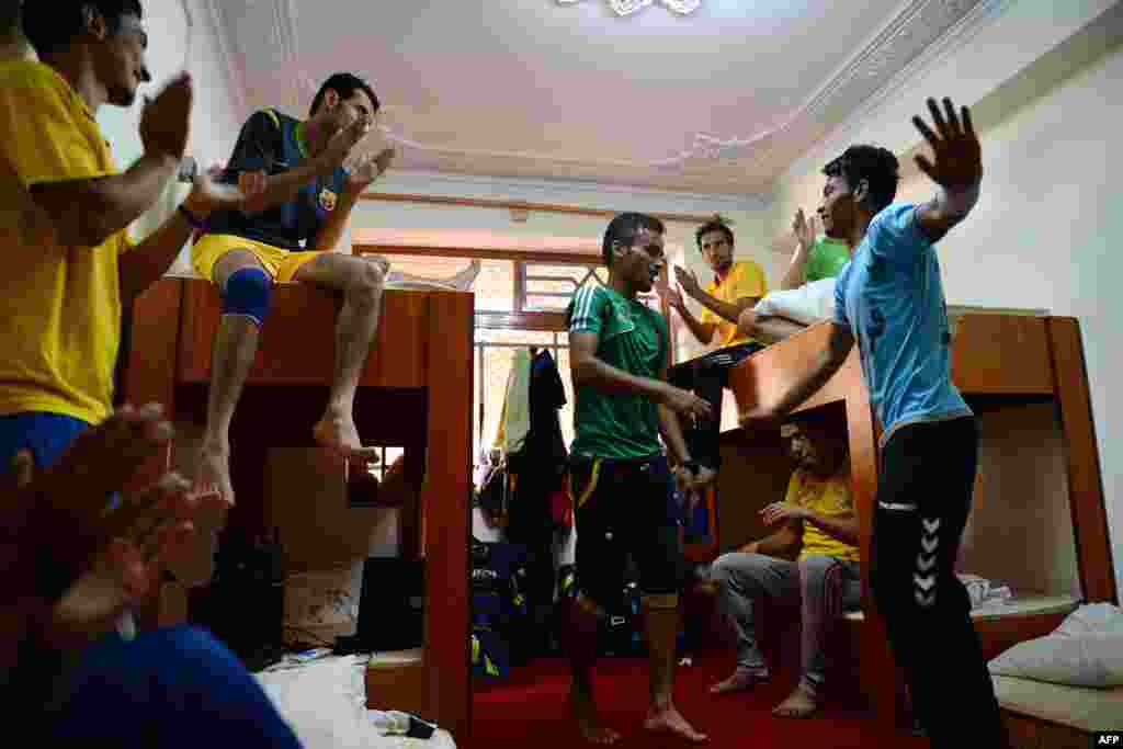 Afghan soccer players dance in their dorm room in Kabul.