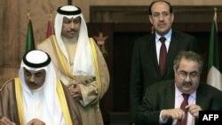 من مراسم توقيع إتفاقية بين العراق والكويت