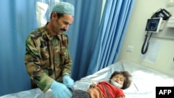 Afghanistan -- A wounded child receives treatment at a military hospital after a roadside bomb blast in Herat, 18Aug2011