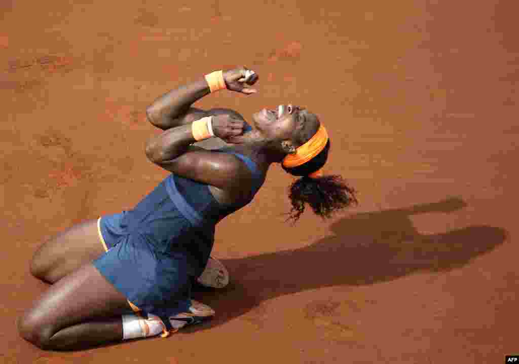U.S. tennis player Serena Williams celebrates her victory over Russia's Maria Sharapova at the end of their French Open final match at the Roland Garros stadium in Paris on June 8. It was Williams' 16th Grand Slam title. (AFP/Kenzo Tribouillard)