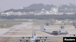 Japan -- Hercules aircraft are parked on the tarmac at Marine Corps Air Station Futenma in Ginowan on Okinawa, 03May2010
