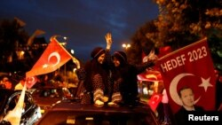 Supporters of AK Party celebrate outside the party's headquarters in Istanbul, Turkey on June 24.
