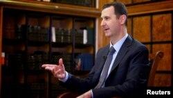 Сирискиот претседател Башар ал Асад.