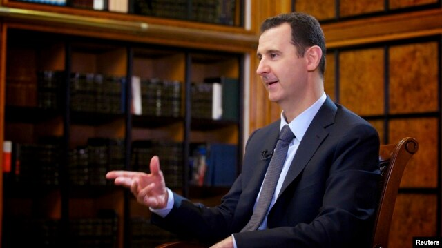 Syrian President Bashar al-Assad speaks during an interview with Russian state television in Damascus on September 12.