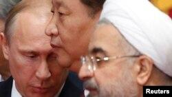از راست: روحانی، شی، پوتین؛ روسای جمهوری ایران، چین و روسیه، در سال ۲۰۱۴ در شانگهای