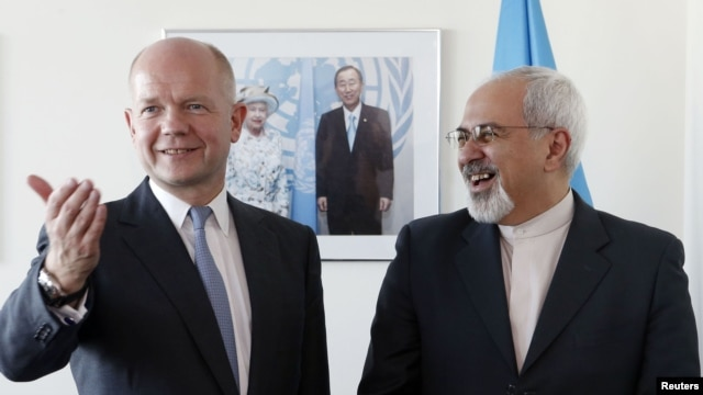 British Foreign Secretary William Hague (left) meets with Iranian Foreign Minister Mohammad Javad Zarif  at the United Nations in New York on September 23.
