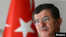 Turkey -- Turkey's Foreign Minister Ahmet Davutoglu is seen during an interview with Reuters in Ankara August 6, 2014.