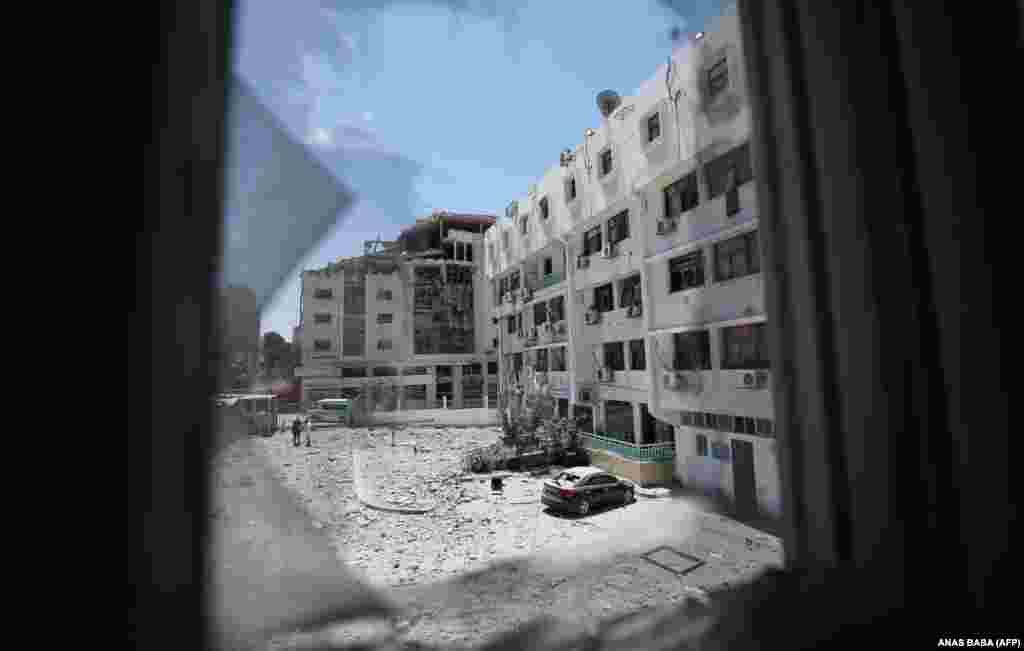 A picture taken on May 19, 2021 through a smashed window shows the building of the Palestinian Ministry of Health in Gaza which was heavily damaged by Israeli bombardment in Gaza City ealier this week.