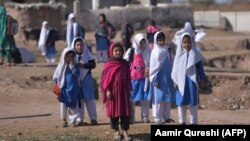 Afghan refugee girls leave school at a refugee camp on the outskirts of Islamabad earlier this year.
