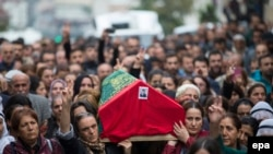 Mourners carry the coffin of a victim who died in one of several explosions, which killed 97 people in the Turkish capital, Ankara, on October 10.