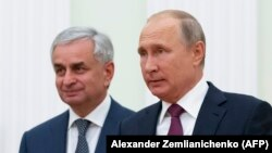 Russian President Vladimir Putin (right) with Abkhazia's separatist leader Raul Khajimba in Moscow last year.