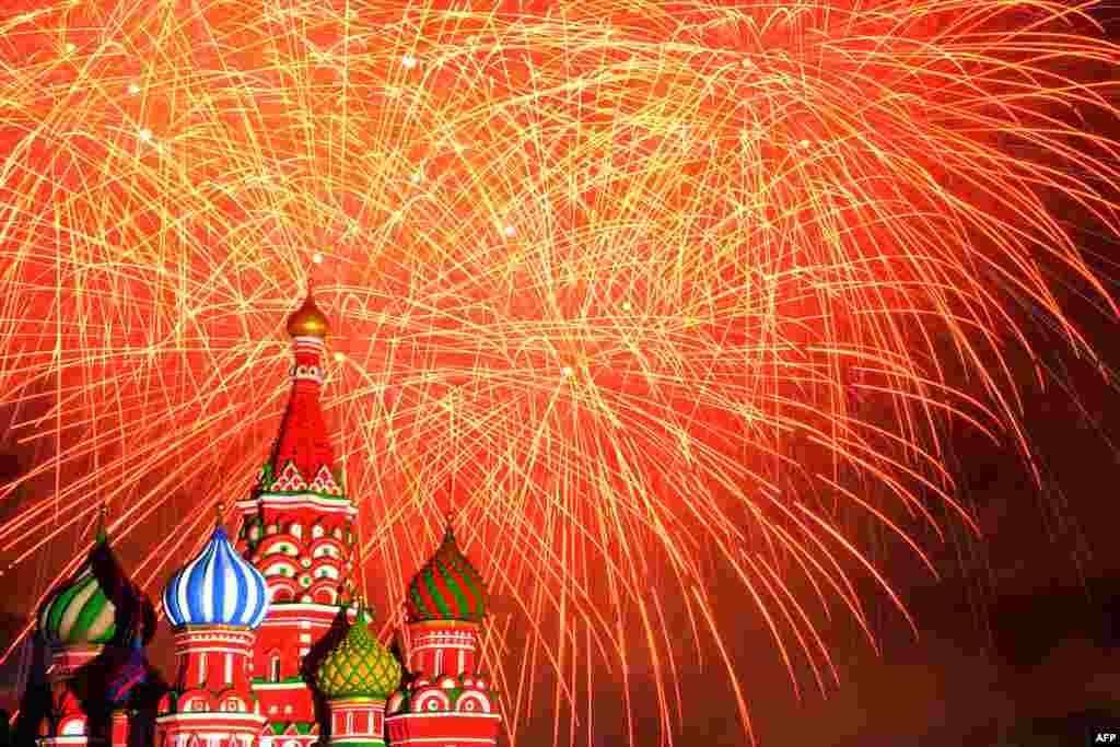Fireworks explode above St. Basil's cathedral during the Spasskaya Tower international military and music festival on Moscow's Red Square. (AFP/Kirill Kudryavtsev)