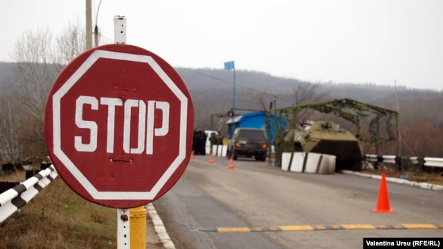Moldova - STOP road sign, checkpoint of peacekeeping troops, Vadul lui Voda, the bridge over the Dniester River, 09Jan2012