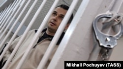 Russia -- Ukrainian film director Oleh Sentsov during a court hearing in Moscow, December 26, 2014