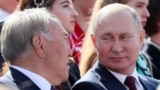 Russian President Vladimir Putin listens to Kazakh former President Nursultan Nazarbayev during the City Day celebrations in Moscow, Russia September 7, 2019. Sputnik/Ekaterina Shtukina/Pool via REUTERS ATTENTION EDITORS - THIS IMAGE WAS PROVIDED BY A THI