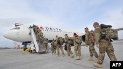 U.S. soldiers from the 438th Medical Unit board a plane on their way home from Afghanistan at the U.S. Transit Center at Manas in March.