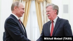 Russian President Vladimir Putin (left) meets with U.S. national security adviser John Bolton at the Kremlin in Moscow on June 27.