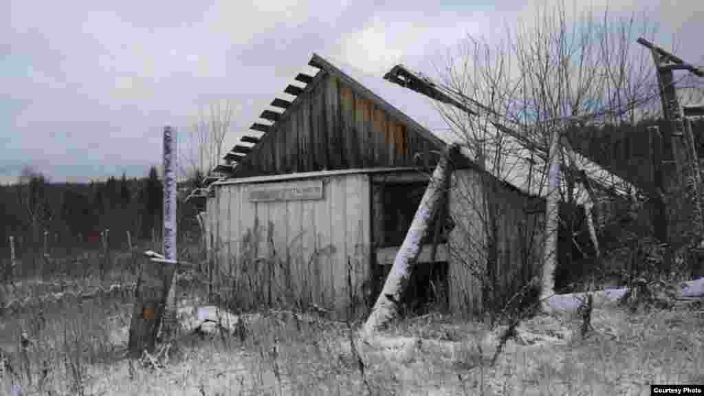 "An abandoned building at Traktovaya bears a sign reading: ""It is not enough merely to recognize one's guilt."""