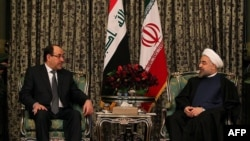 روحاني والمالكي خلال اجتماعهما في طهران - 5 كانون الأول 2013