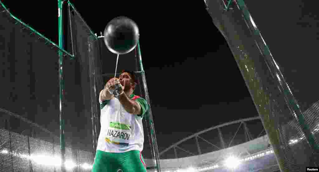 Dilshod Nazarov of Tajikistan on his way to winning the men's hammer competition. It was his country's first ever gold medal in the Olympics.