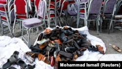 he shoes of victims are seen outside a damaged wedding hall after a blast in Kabul on August 18.