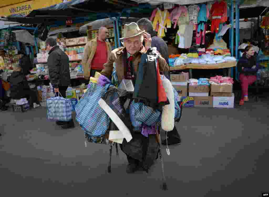 An elderly man sells plastic bags at the central market in Chisinau, Moldova. (AFP/Daniel/Mihailescu)