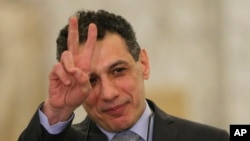 Nizar Zakka a Lebanese citizen and permanent U.S. resident who was released in Tehran after nearly four years in jail on charges of spying, flashes victory sign at the presidential palace, in Baabda, east of Beirut, Tuesday, June 11, 2019.(AP Photo/Hussei