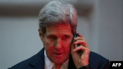 U.S. Secretary of State John Kerry talks on the phone in Vienna on November 21 during negotiations aimed at settling a dispute over Iran's nuclear program.