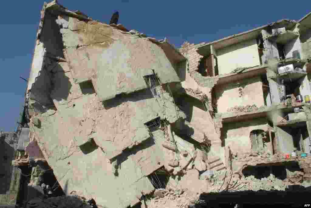 Дом, разрушенный в результате авиаудара. Алеппо, 24 декабря 2013 года