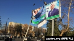 A billboard of presidential candidate Khatamjon Ketmanov -- one of three official candidates allowed to run against Mirziyaev.