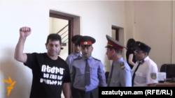 Armenia - Retired Colonel Volodya Avetisian (L) stands a trial on fraud charges, Yerevan, 26May2014