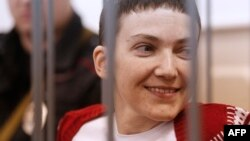 Ukrainian pilot Nadia Savchenko stands inside a defendant's cage during her hearing in the Basmanny district court in Moscow on February 10.
