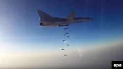 A Russian Tupolev Tu-22M3 long-range bomber based in Iran drops bombs at an unknown location in Syria. (file photo)