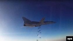 A still image shows a Russian Tupolev Tu-22M3 long-range bomber based in Iran dropping off bombs at an unknown location in Syria.