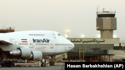 File photo - A Boeing 747 of Iran's national airline is parked at Mehrabad International airport in Tehran, Iran.
