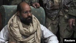Libya -- Saif al-Islam Qaddafi after his capture, in the custody of revolutionary fighters in Obari, 19Nov2011