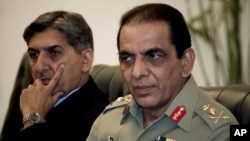 Pakistan's ISI chief Ahmad Shuja Pasha (left) and Army chief General Ashfaq Parvez Kayani at a June 2011 meeting