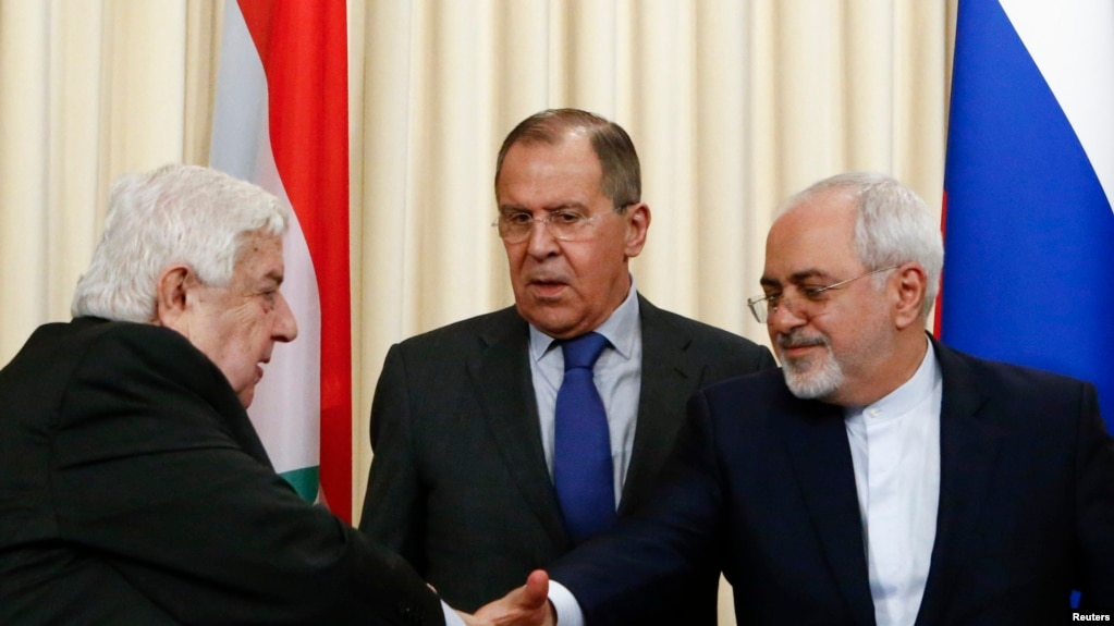 Foreign Ministers, Sergei Lavrov (C) of Russia, Walid al-Muallem (L) of Syria and Mohammad Javad Zarif of Iran, attend a news conference in Moscow, April 14, 2017
