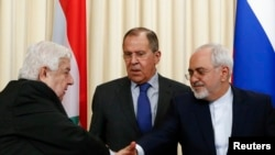 Foreign Ministers, Sergei Lavrov (C) of Russia, Walid al-Muallem (L) of Syria and Mohammad Javad Zarif of Iran attend a news conference in Moscow, April 14, 2017